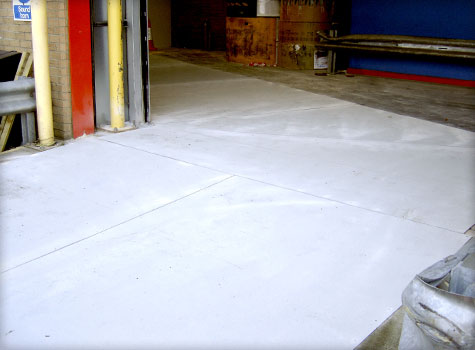 4. Sheets cut around sensors in the floor for automatic forklift entrance doors.