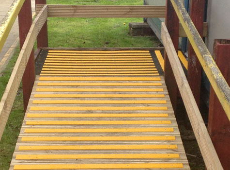 Slippery Wooden Ramps With Gritted Decking Strips.