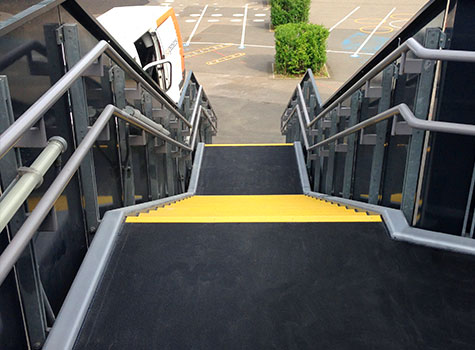 Custom cut floor sheets for platforms and ramp areas, installation completed.