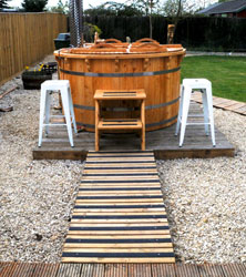 Garden hot tub area with decking strips
