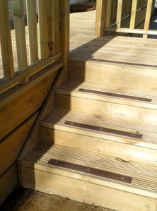 Holiday home steps with decking strips