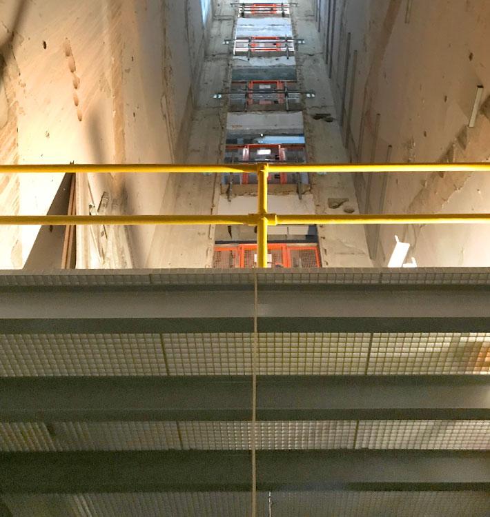 Riser shaft flooring in progress.