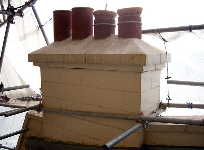 Before: Original Masonry Chimney.