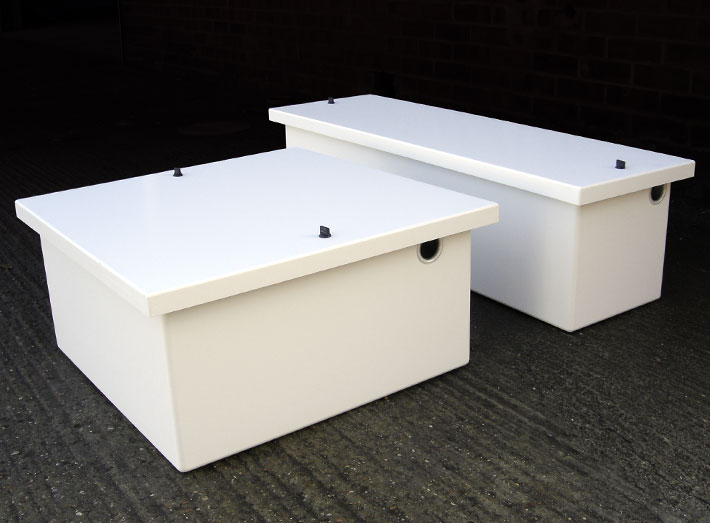 GRP acid resistant boxes for safe storage of batteries on a boat engine room.