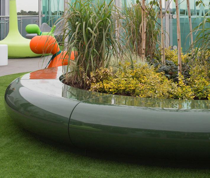 Ultra contemporary in design, the Corona planter compliments the departure lounge roof terrace seating area.