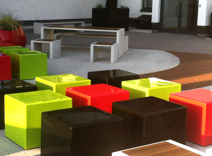 The vivid red Cubes and the vibrant green Cubes contrast with the coal black Cubes giving the seating area the unique and modern look that was desired.