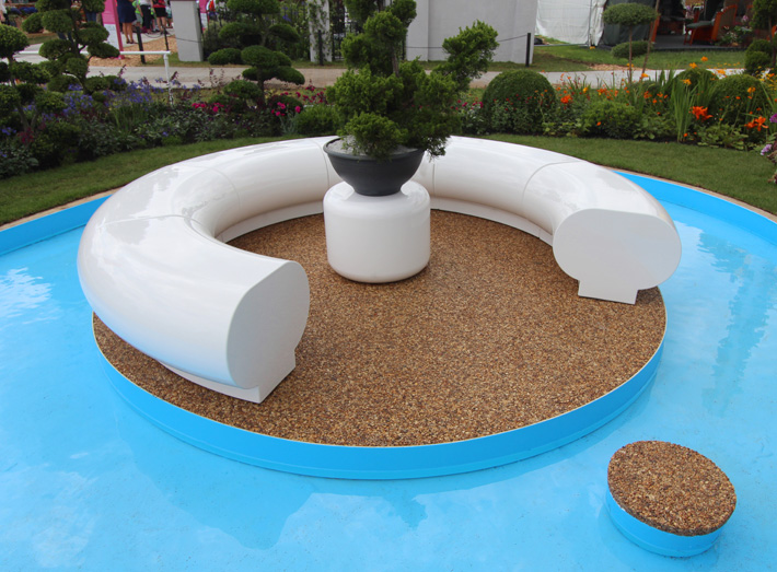 Taking centre stage within the 'Journey of Life' garden is a meditative pool created with our Halo seating.