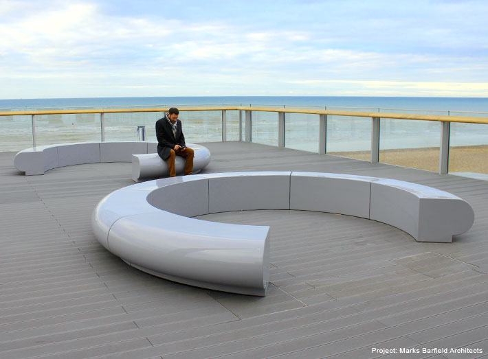 Corona circular seating. Understated yet elegant modern outside seating in cool grey blends into the seascape.