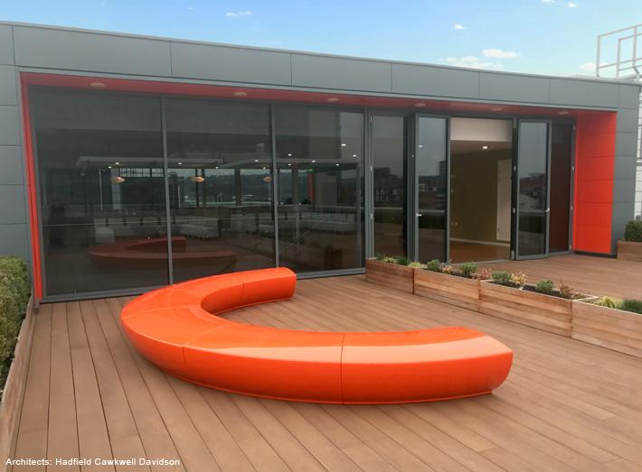 Serpentine seats in orange where chosen to match a corporate colour scheme.