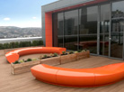 Serpentine seating adds colour to Westfield Health's Wellbeing Zone in Sheffield.