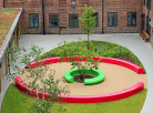 Arena & Corona create an eye-catching seating centrepiece for prestigious International school...