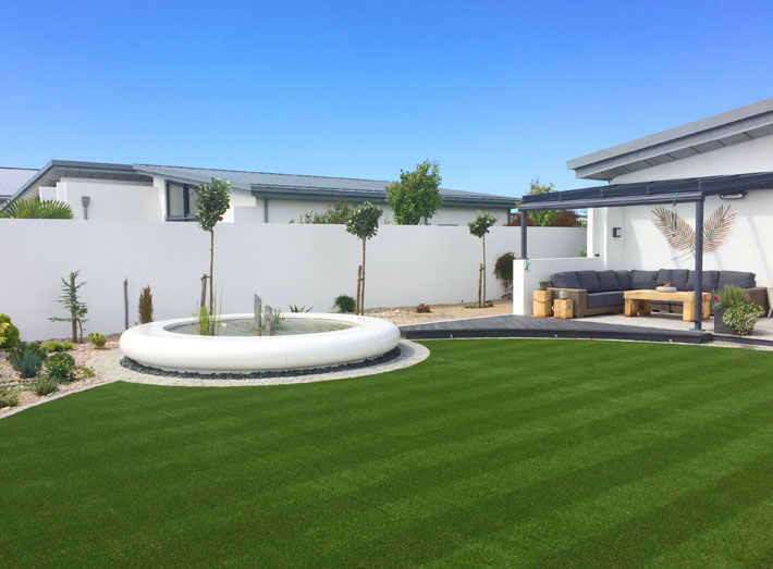 A white Aqua Corona Water Feature was the centrepiece of choice for a landscape garden design on the sunny Isle of Jersey.