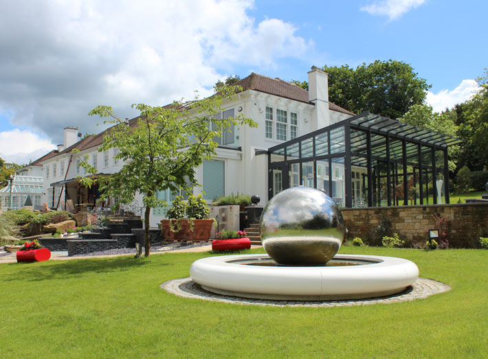The contemporary water feature was specified to sit alongside an outdoor modern art collection.