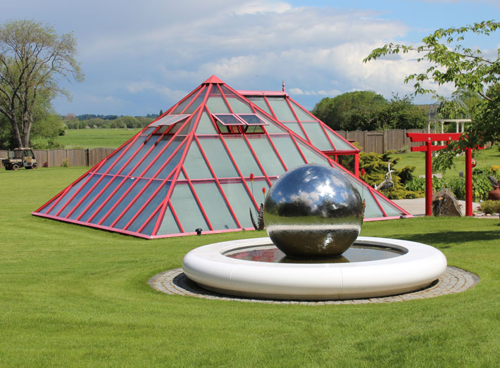 The water feature also provided the perfect home for Uri Gellers spherical art sculpture too.