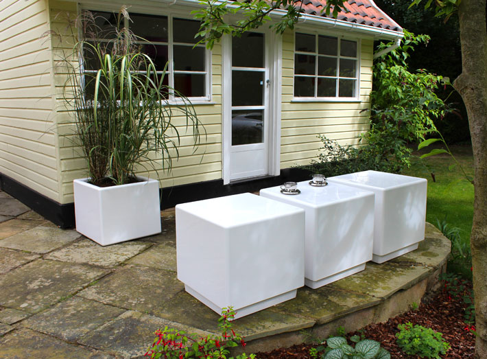 Cube seating, tables and matching planters can be adapted to fit any size of space.