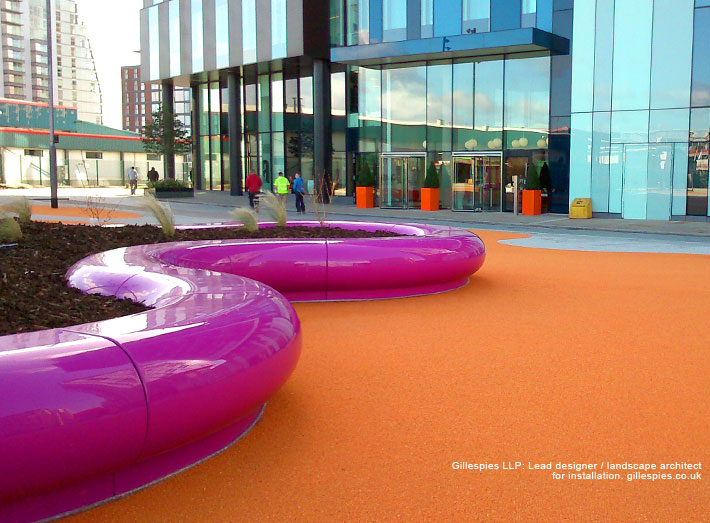 An orange central open area for events with snaking Halo seating arrangements.