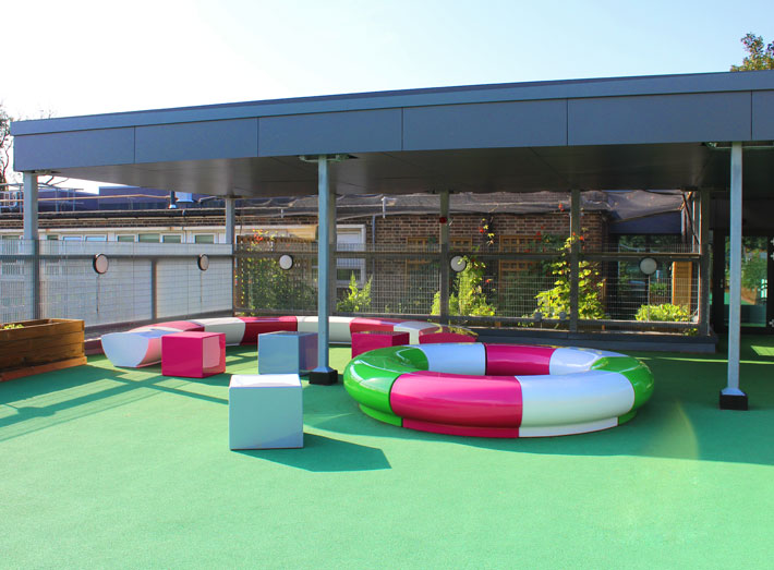 Halo seating specified for Earlham Primary School in Stratford, London, creating colourful fun spaces for children to engage with their learning and play.