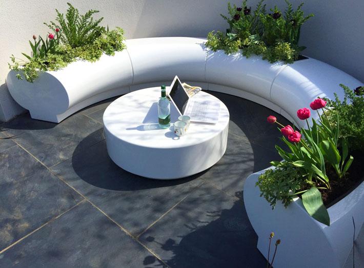 Halo seating and matching planters award winning RHS Malvern garden design.