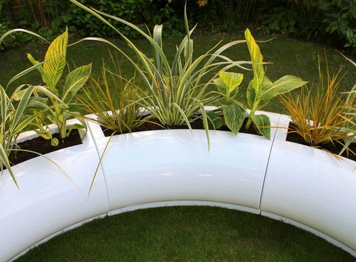 Halo, curved modular planter designs, easy to install and can be adapted to fit any size of space.