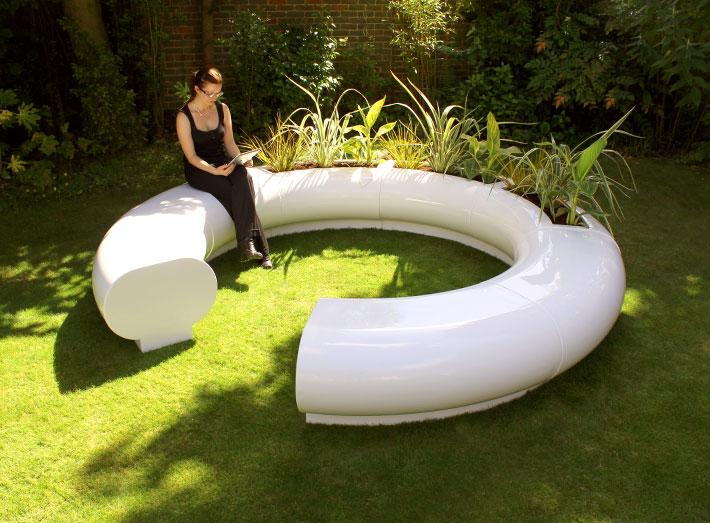 Hand-crafted Halo sectional seating and matching Halo garden planters.