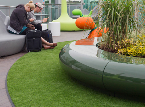 2. Airport roof terrace with Corona planter and seats.