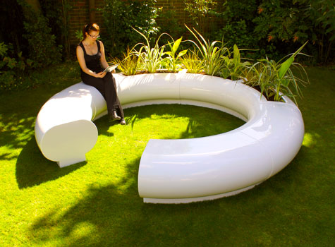 13. Hand-crafted sectional seating and matching Halo garden planters.