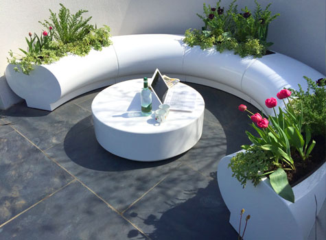 1. Halo planters and matching seats garden design.