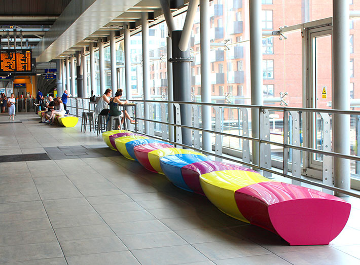 Serpentine seats curve together to create a snake-like pattern.