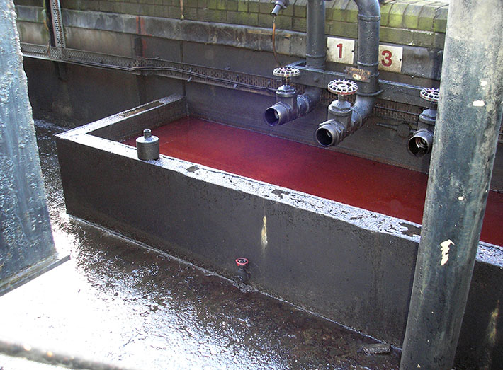 Contaminated diesel bund, prior to cleaning and fibreglass matting.