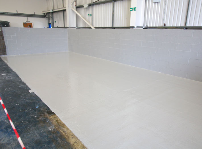 GRP lining of the floor and three walls completed, ready for tanks to be manoeuvred into position.
