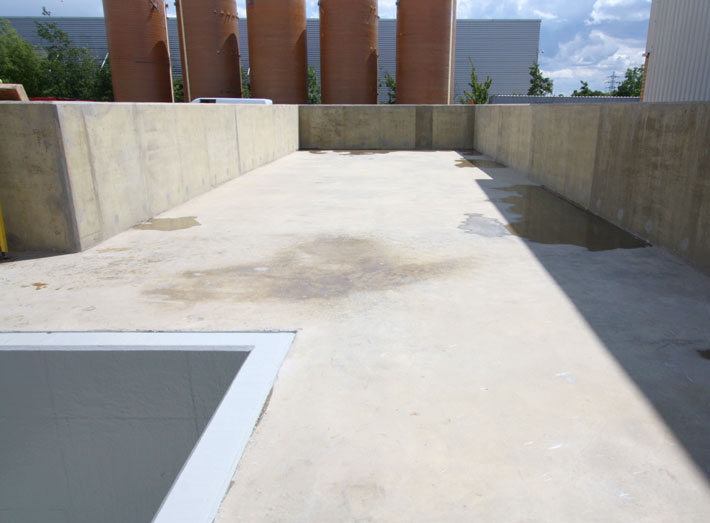 The concrete bund area now ready for fibreglass matting.