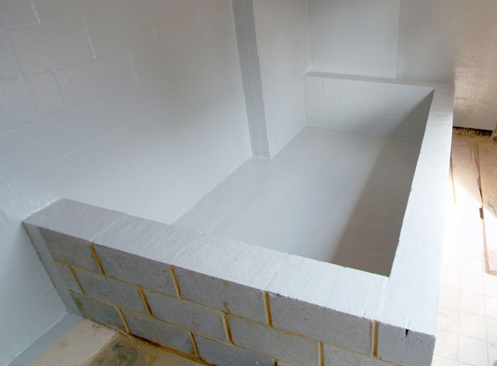 After: completed fibreglass lining to bund floor and walls, and walls of orthophosphoric acid dosing room.