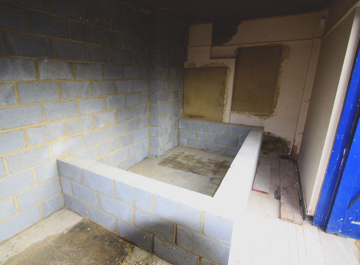 Before: concrete and block bund within acid dosing room of a water and waste water management company.