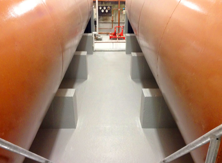 Generator bund: fibreglass matting moulds to the internal surfaces encapsulating tank plinths, upstands and pedestals.