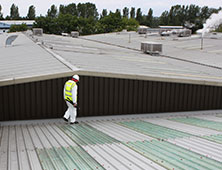 GRP lining of roof top gutters and gullies