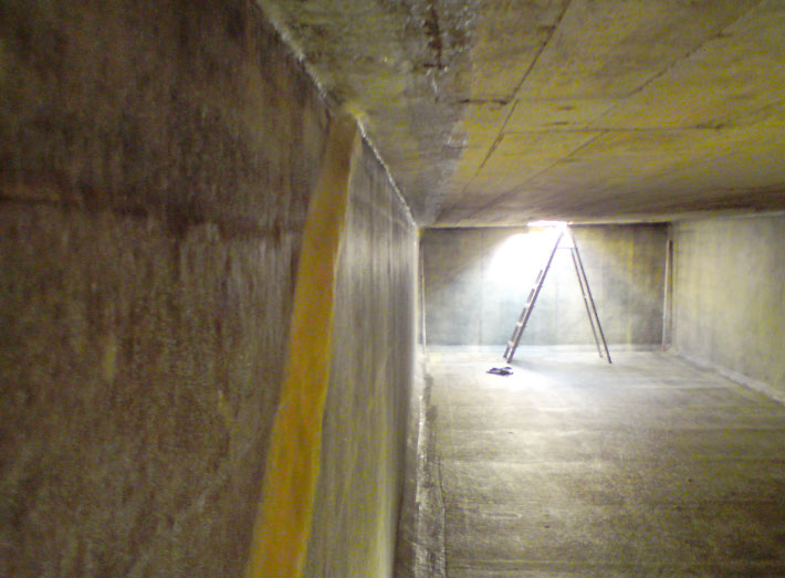 Prior to lining, the damaged areas of water storage tank walls.