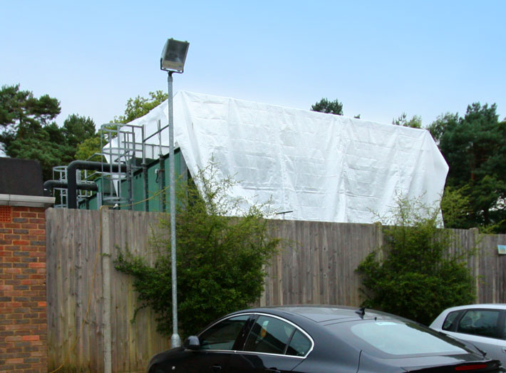 Application of a fibreglass lining to a Hospital potable water storage tank.