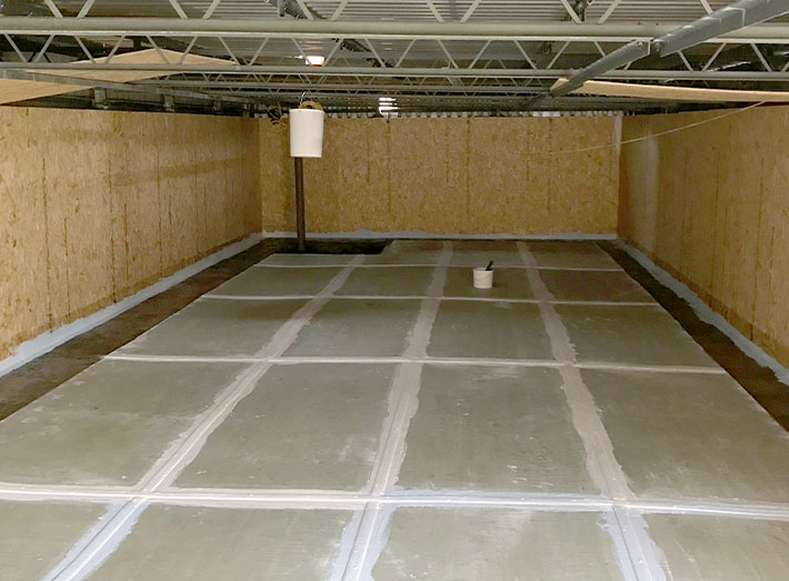 Any contamination removed and surfaces carefully prepared, floor levelled and floor sheets applied and bonded.